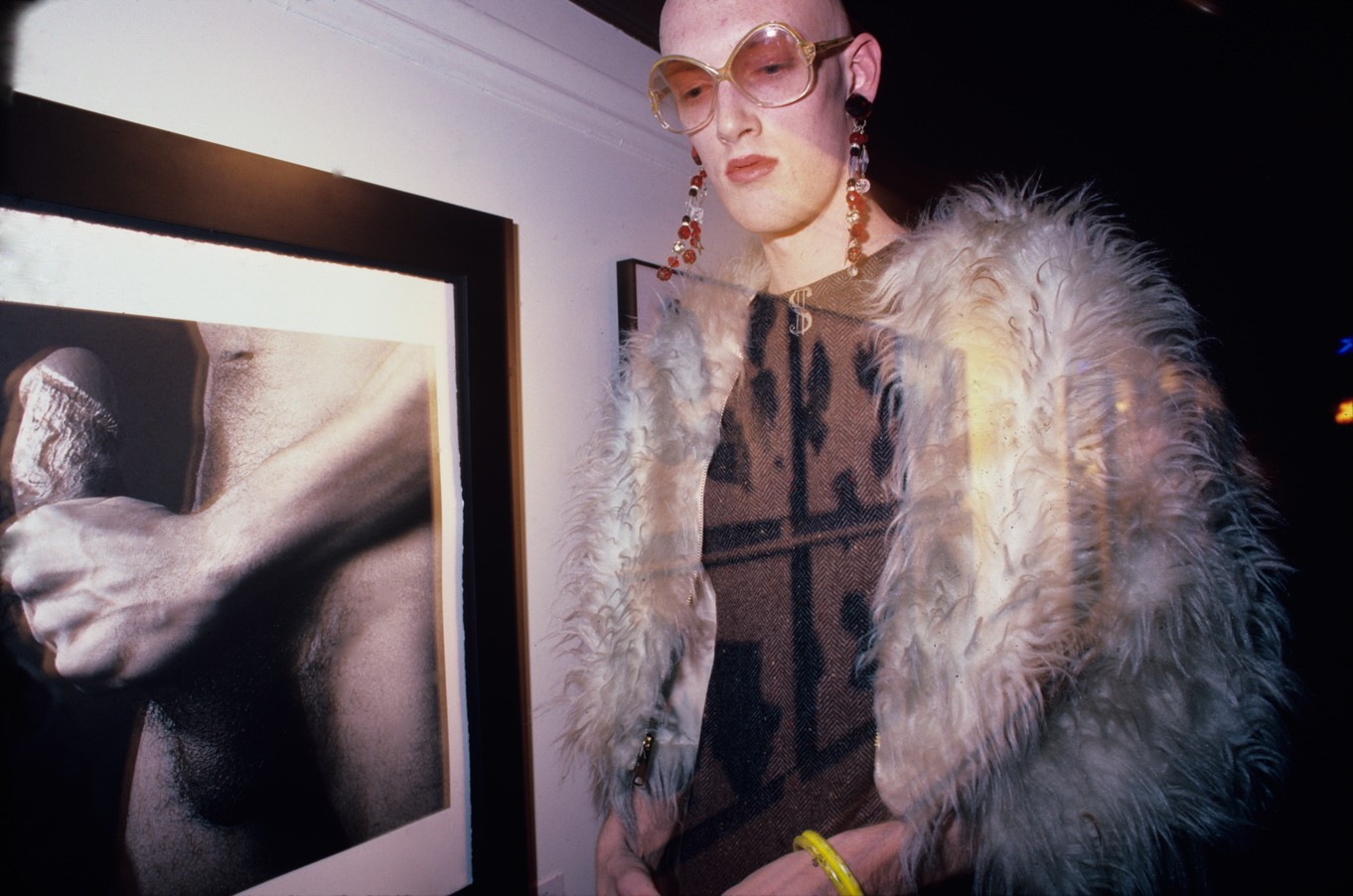 Guest in Front of a Mapplethorpe Photo at the Area Club, NY 1985